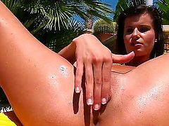Perfectly tanned brunette Megan teases us in the pool. She dabbles with her naked pussy and caresses it with fingers in front of the camera. This babe is really hot thing.