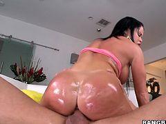 She shows off her sexy ass first and then starts teasing him. He rubs her ass with oil and then sticks his cock in between her legs.