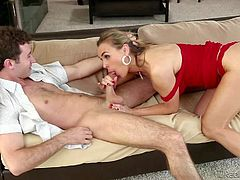Tanya Tate is a smoking hot milf with big tits. Lady in red bares her assets and takes young sturdy dick in her mouth. She gets her pussy slammed on the couch after dick sucking.