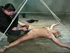 Slutty blonde Marie has her body all tied up and her legs spread on the floor. Her horny executor enjoys touching her wet shaved pussy and torturing it at the same time with a lot of laundry pliers. He tickles it, but doesn`t let her cum too soon. He first wants to bring a vibrator in the scene. So hot!