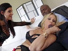 India Summer and Julia Ann are playful bisexual milfs who play with each other before they take big chocolate cock. Brunette and blonde kiss and then give head to well hung guy.