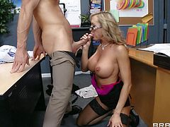 Dean Brandi Love is a smoking hot milfy woman with huge boobs. This gorgeous busty woman in stockings and shoes parts her legs and gets her twat tongue fucked for a start. Then glassed lady finds herself on her knees giving titjob.