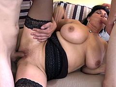 Fat mature lady Violette V has a gangbang with two young men on the couch. She gets fucked hard in the pussy by one while she suck the other guy's hard cock. She gets two sticky loads of cum sprayed on her.