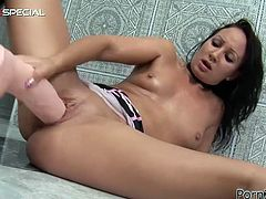 Have a look at this solo clip where a horny brunette wearing a seductive outfit has some fun masturbating and sucking on a huge dildo she found hanging on a wall.