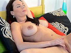 Fascinating brunette temptress with large boobs Kyla Fox stimulating her warm pussy