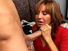 Hot and mature Tara Holiday with her big boobs and an excellent body despite her age is fucking and sucking really hard with a handsome young stud on comfortable bed in his room.