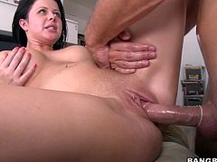 Charming tattooed brunette Loni lets some guy oil and rub her nice body. Then she favours him with an admirable blowjob and they bang in various positions on a couch.