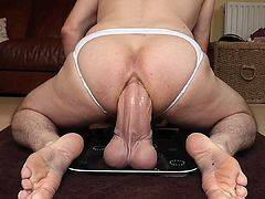 Gigantic 13.5 inch dildo gets ridden deep by hungry wet as