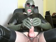 A cock covered in transparent latex, latex gloves, mask, stockings, leather overknee boots - makes me so horny. The result: massive cum eruption