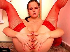 Well this bitch with droopy tits is far from being really hot and sexy. Pale hooker in red stuff and stockings has ugly bright makeup. Torrid wanker sits right onto the floor for fingering her wet pussy. Satisfaction is what perverted bitch needs today.
