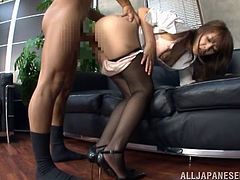 Amazing Japanese chick gives handjob and blowjob to a guy in the office. After that she gets fucked hard on a sofa.