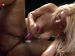 Busty Cookie is a heavy category milf. She likes to get her vagina fucked hard and this skinny blonde will have to do her best. She rubs Cookie's pussy, fingers it and then uses a dildo to warm her up. Now that the ebony cunt is ready the sexy blonde uses her small hand and goes inside that big wet pussy