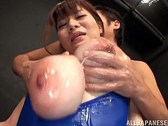 Japanese babe gets her huge boobs oiled up. After that she spreads her legs and gets fucked in her hairy pussy.