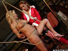 Ginna Brigitta is having fun with horny mistress Regina Ice. Regina ties Ginna up, spanks her and then destroys her throbbing snatch with a dildo.