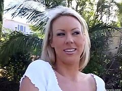 Carolyn Reese is a sexy blonde who wants to jerk off you cock. She looks in your eyes as she whacks you off. she shows of her heaving chest and beats off your meat until you blow your spunk all over her chest.