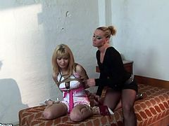 Salacious mistress Kathia Nobili is having fun with cute chick Novigina in the bedroom. She ties her up, strokes her body and then drills her nice pussy with a dildo.