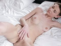 Superb beauty loves finger fucking her twat and having it get wet and warm
