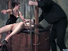 Sweet brunette Charlotte Vale is having fun with a guy and a girl in a basement. She lets the guys tie her up and then gets her pussy finger-fucked by the girl.