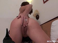 Skinny mature in glasses stripping and toying her horny cunt