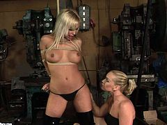 Adriana Russo has fun with lewd mistress Kathia Nobili in some weird place. Kathia ties the girl up and then slams her nice pussy with a dildo.