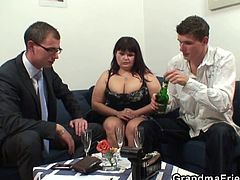Initially, this mature fatty was just taking a few sexy pics. These two young men give her their cocks to suck and to please her fat cunt.