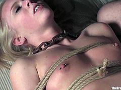 Hot and amazing bondage plays with a smoking hot blond sex slave! She gets tied up and then he pokes her holes with his cock.