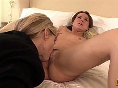 Horny blond milf seduces this petite redhead honey and gets that tight pussy of hers. She sticks a huge strapon dildo in her and makes her stun so fucking loud!