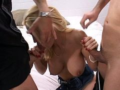 Gorgeous blonde milf Diamond Foxxx is having some good time with two horny men. She pleases them with a blowjob and then lets them drill her pussy by turns.