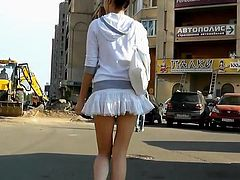 Superb hottie gets filmed by voyeur under her sexy skirt revealing her panties