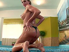 Cathy Heaven swims in a pool and plays with her cute wet pussy