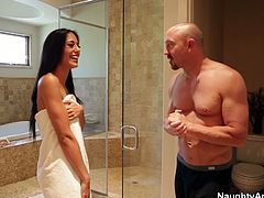 Horny girl fornicates with a bald guy in a bathroom. She kneels down to give fantastic blowjob. She works her pretty mouth on a hard stick stroking the stem actively.