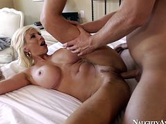 She is luscious blonde hoe with big fake boobs. She is poked in her twat in a missionary position. Then she tops the rod riding in cowgirl position.