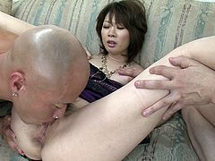 Asian slut Rio Kagawa takes part in a wild threesome. She gets her sweet tits caressed and wet pussy licked by two horny guys.