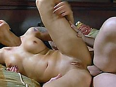 Blonde and a brunette babes have all their holes punctuated by a fat meat-stick that also splatters their faces with its juice.