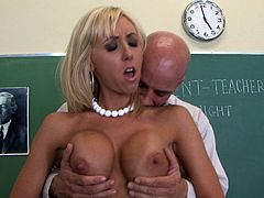 Horny blonde milf teacher enjoys huge cock pounding her tight pussy while at school