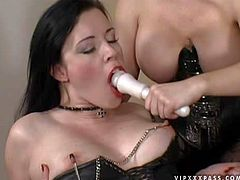 Long haired brunette bitch Anastasia Pierce with enormously big fake melons in leather boots and corset spanks her pale girlfriend with natural tits and plays with her in arousing bondage action