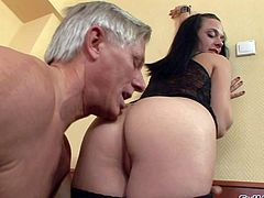 Pretty brunette Terry C in barely there black dress shwos fof her sexy juicy ass to older hard dicked man Christoph Clark. He spreads ehr buttocks and fingers her anal hole before she gives head.