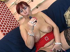 Darina B. is sitting on the couch when she pulls her breasts out so you can get a good look at them. She spreads her legs so you can see her old cunt. She fingers her pussy then moves on to uses a vibrator on her vagina.