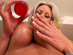 Carolyn Reese knows how much guys love her tits and she is letting this dude have a field day with her beauties. She even pours hot wax on them to make him lose his mind a bit faster.