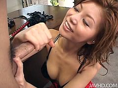 Insatiable Japanese domina in peppering latex lingerie and fishnet stockings puts a collar and leash on her boss before she stands on her knees to give him a fantastic blowjob and hand job until her jizzes.