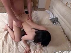 Naughty Japanese girl strips her clothes off and then gives a footjob. After that she also sucks and rides a dick passionately.