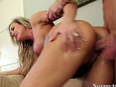 Naughty girl Brandi Love sucks hard dick deepthroat. Then she bends over the couch lifting up her skirt. The guy penetrates her wet twat from behind banging her hard. Tasty porn clip made by Naughty America productions.