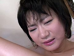 Kinky tied up Japanese chick moans throughout the bathroom. Spoiled bald headed dude drills her hairy pussy with the wine bottle neck and enjoys the way girlie spins and groans.