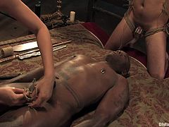 Here is a scene that is not easy to forget. This nasty bitch has a field day entertaining these two studs, tying them up and bounding them. Ouch!
