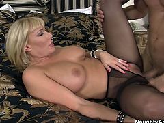 Busty blonde MILF in crotchless pantyhose always gets what she wants. She lies on a bed stretching her legs wide and moans with pleasure while getting her pussy expertly eaten out. Later he fucks her hard in missionary pose.