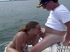 Slutty long haired brunette Jessica Stone with sunglasses and ponytail reveals her huge natural knockers to Josh on his boat and takes on his stiff meaty anaconda in close up