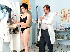 Seductive brunette granny bends over in order to gets her hairy asshole banged with medical tool. Later she gets examined by kinky gynecologist.