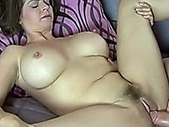 Busty babe sucking on a huge cock