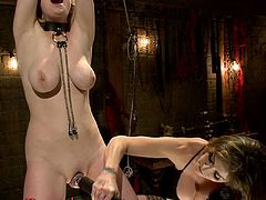 This mistress is very serious about torturing and using her blonde slave. She makes her lick her pussy and she drills her ass with a strapon.
