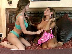 Today we have an amazing lesbian scene with two hot chicks. First, they undress each other slowly during their foreplay, then they please one another with sensuous pussy fingering.
